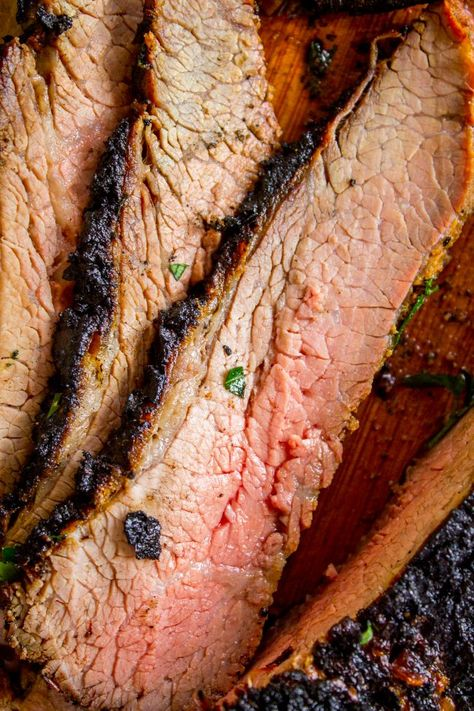 How to Cook Tri Tip (Grilled or Oven-Roasted) from The Food Charlatan. If you've never had tri tip, you haven't lived! I will show you how to cook tri tip on the grill or in the oven. It's SO easy and the flavor is unbeatable! We always had tri tip for Christmas dinner growing up, it's an impressive holiday dinner! #intheoven #grilled #garlic #recipes #marinade #dinner #bbq #howtocook #rub #sandwich #santamaria #seasoning #steak #baked #roast #Christmas #Thanksgiving #Easter #beef #best