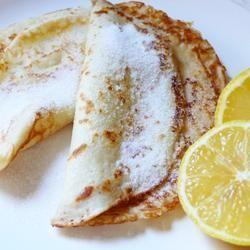 Traditional pancakes with sugar and lemon
