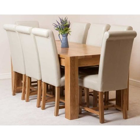 chunky solid oak dining table and 8 chairs