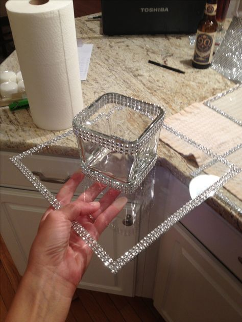 Dollar tree crafts - clear glass from pic frame and votive candle holder line with rhinestone ribbon from Michaels!
