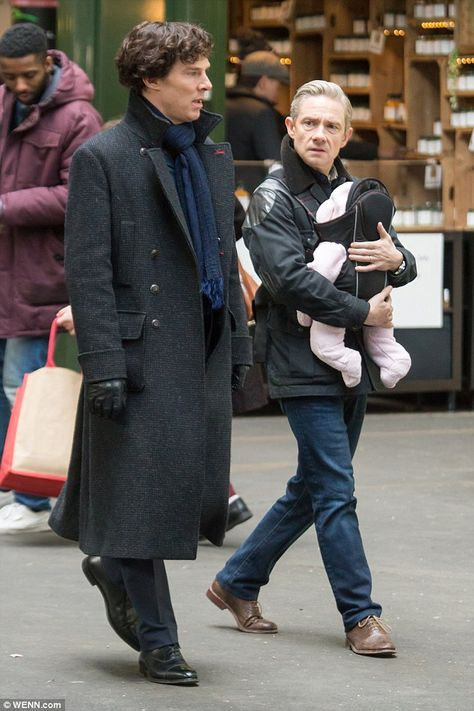 Wearing jeans and a warm jacket, Watson certainly looked like a doting father as he kept his firstborn close to his chest.