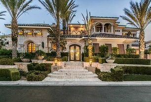 Mediterranean Exterior Of Home With Exterior Stone Floors Pathway