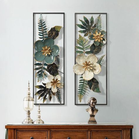 These floral pieces of art on your wall gives a unique look to the entire room.The 2 varients measures the same: 89cm x 31cm and can be bought online in India from www.shahisajawat.com