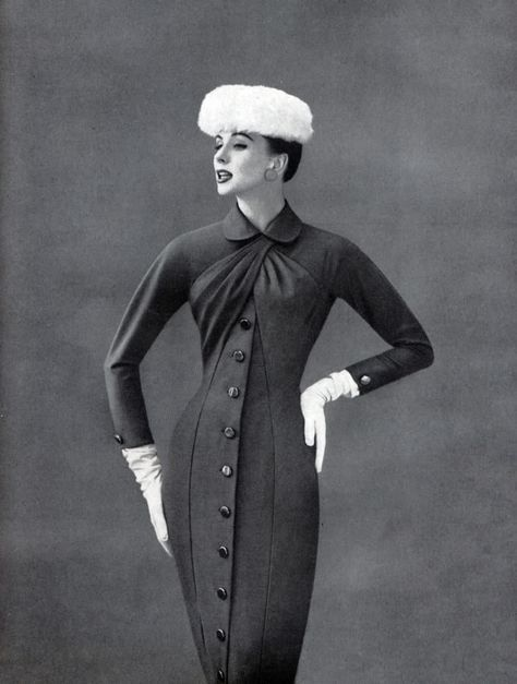 Love the wrap around style bodice on this curve hugging dress being worn by Suzy Parker, 1955
