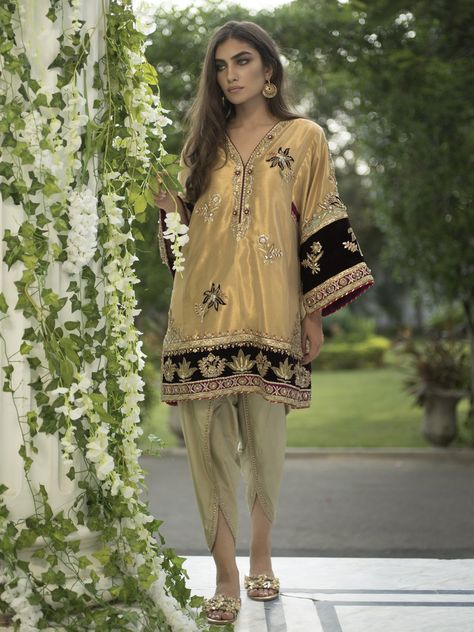 Our Alisha Kurti is inspired by the Kashmiri water gardens. It is styled with a shaded pistachio dhoti shalwar. Pink lamé-like tissue Shaded pistachio Kathan silk Dry clean.