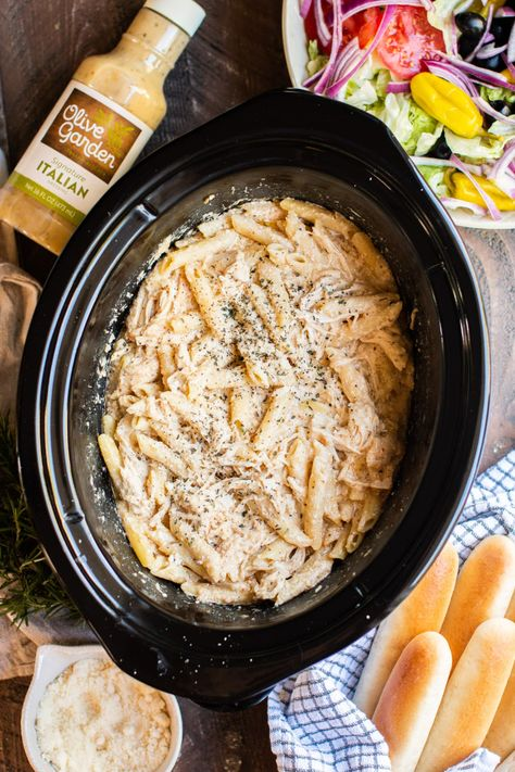 Use Olive Garden Italian Dressing to make this Slow Cooker Olive Garden Chicken Pasta! It's a creamy pasta dish that has so much flavor. - The Magical Slow Cooker #crockpot #slowcooker #olivegarden