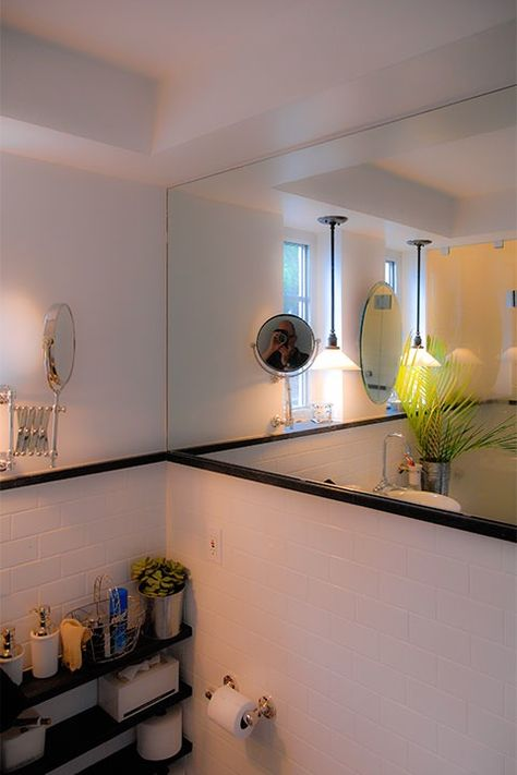 Circular Telescoping Mirror Catches The Photographers Reflection Off A Larger Wall Of That Doubles Size Bathroom