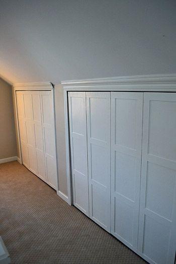 Attic Closet Ideas Walk In Attic Room Closet Features A Sloped Ceiling Lined With Rustic Wood Light Beam Attic Bedroom Storage Attic Remodel Attic Renovation