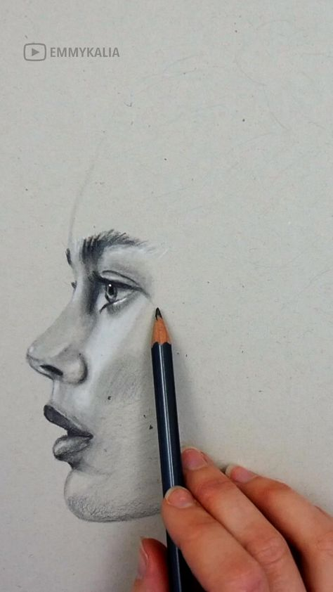 Graphite on Grey Toned paper. Shading a face by Emmy Kalia