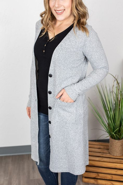 This light heather grey cardi is the perfect neutral! Longer than a traditional cardigan, but not quite full-length like a duster, we think this length is perfect! Plus, its so soft you'll never want to take it off! Model: wearing a size small Fit: runs true to size Fabric: 90% polyester and 10% spandex
