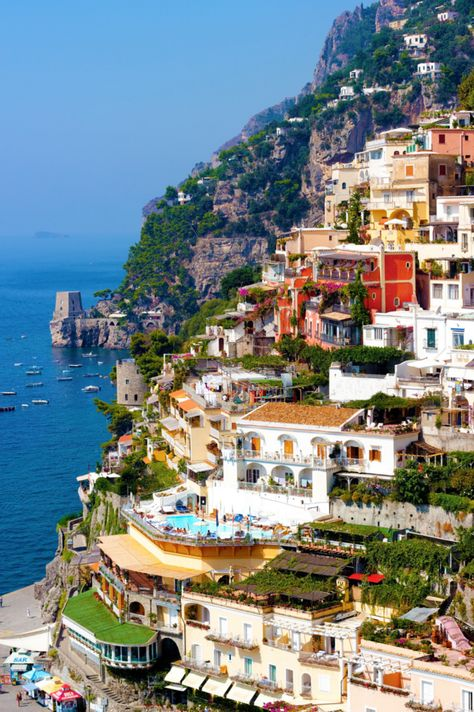 Positano, Italy on the Amalfi Coast - Located a couple of hours south of Rome and perched along the cliffs of Southern Italy, The best of Italy travel. What hotel to stay at, what restaurants to eat at, and what to do.