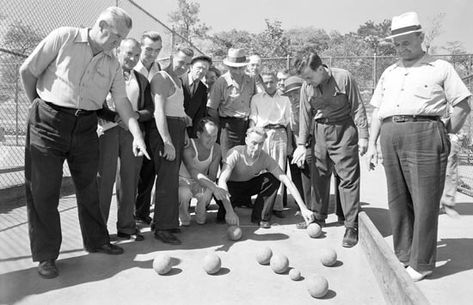 Men gather on the Crotona Park bocce courts, September 18, 1941. Courtesy of Parks Photo Archive, Neg. 20735.