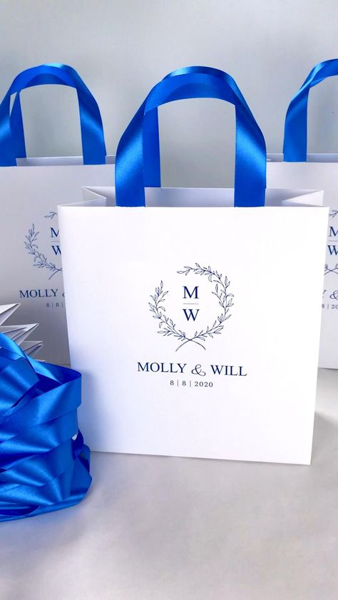 Wedding Monogram Gift Boxes, Video Review; shared by Buchwald Jewelers Miami, the Diamond Store since 1932 #weddingmonogramboxes #weddinggiftboxes #weddingboxvideo #videoreviewweddingbox #blueweddingboxes #weddingwelcomebox