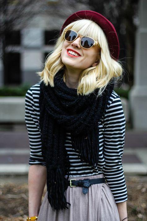 Black scarf, red bowler hat, stripes