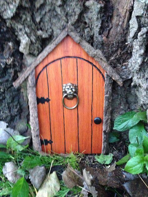 Gnome door, fairy door, or tree door with lion knocker