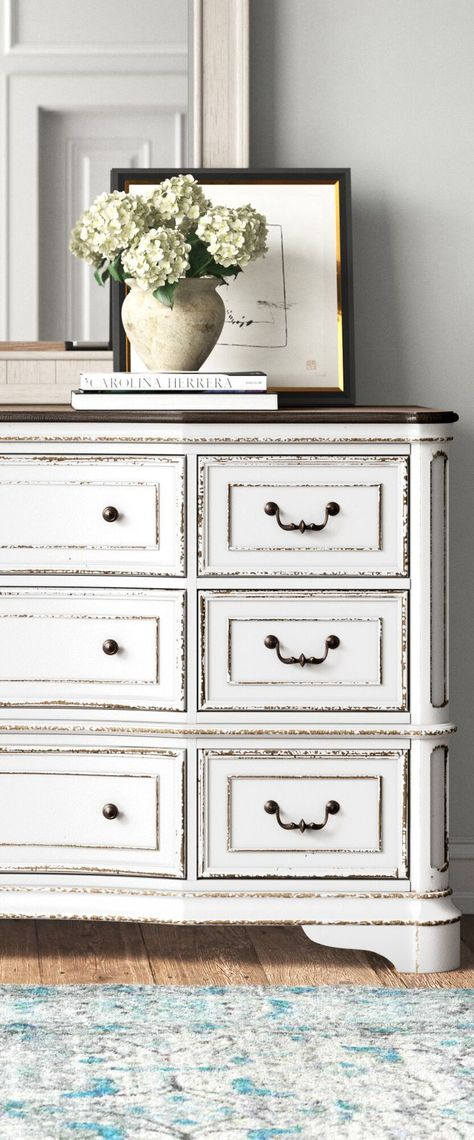 This 9-drawer double dresser has plenty of room for your entire wardrobe, from socks to jeans. #farmhouse #farmhousestyle #countrybedroom #farmhousemasterbedroom #decoratingideas #masterbedrooms #masterbedroomideas