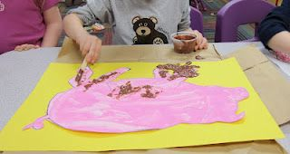"Kids make their own ""mud"" (sand, oatmeal and brown paint)."