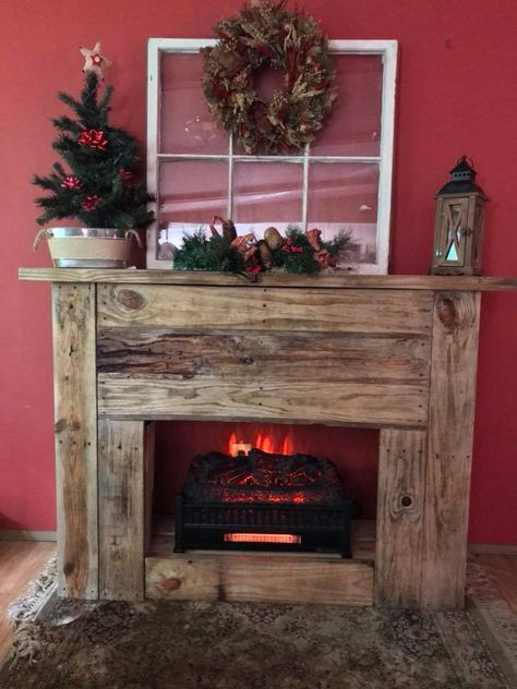 I built this fireplace out of pallet wood for my grandson because he was concerned how Santa would be able to leave our gifts lol!