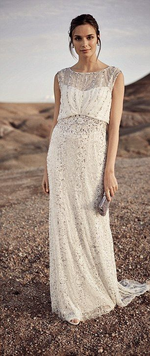 Phase Eight's Hope Twenties inspired wedding dress heavily embellished with shimmering bea...