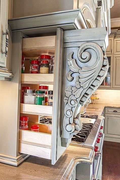 Not just for decoration anymore -- ornate moldings pull out to reveal hidden pantry storage! Good, sneaky idea for hidden storage. Hidden Shelf, Hidden Pantry, Hidden Storage, Hidden Kitchen, Extra Storage, Secret Storage, Kitchen Small, Pantry Storage, Kitchen Storage