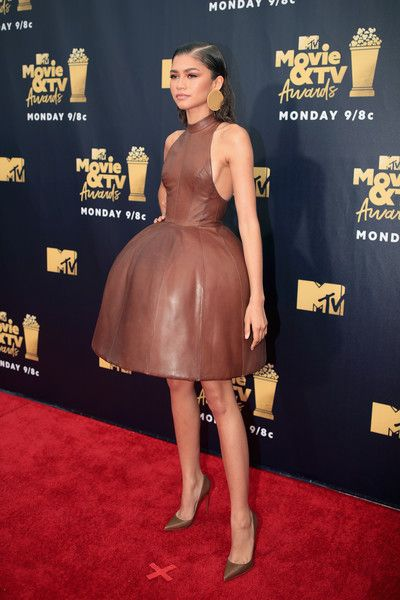 Actor Zendaya attends the 2018 MTV Movie And TV Awards at Barker Hangar.