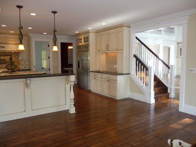 Love the stairs opening up to the kitchen--- the epicenter of the ...