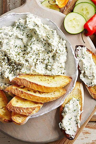 This ricotta and parmesan cheese spread makes a delicious Memorial Day appetizer. Serve it with toasted bread, or sliced veggies. #memorialdayideas #memorialdayparty #sidedishideas #partysidedish #bhg