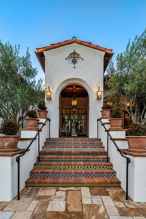 Beautiful traditional Spanish steps leading to the entrance of this beautiful home.