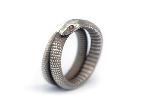 A ssssnake… well, to be honest, not my favorite type of animal… but a little, clever snake-pet woul be nice…  living winded around a finger of my hand… eating annoying mosquitoes and biting bad people! Silver ring, manufactured via Shapways 3D printing service.