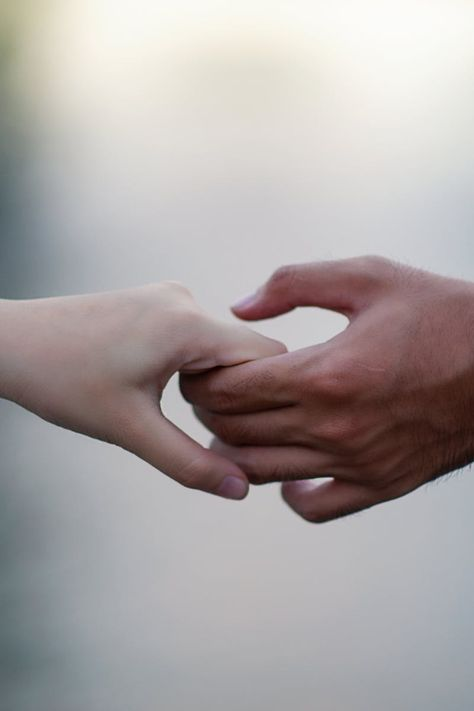 Man and Women Holding Hand