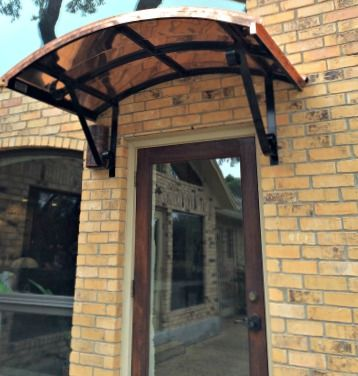 The Copper Eyebrow Door Awning With The Single S Scrolls In Katy Tx Door Awnings Metal Awning Beautiful Doors
