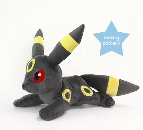 How to sew Umbreon Pokemon plush with this DIY plush sewing pattern and photo tutorial! Learn how to make your own high quality handmade plushies using my helpful sewing techniques and tips.  ** This is a digital PDF for the sewing patterns & instructions only. Paper pattern, eyes, materials, accessories, or finished product are not included. **  Umbreons eye embroidery is here: https://www.etsy.com/listing/474371913  Umbreon is 18″ long and 10.5″ tall, the perfect cuddle size! It is a wonder...