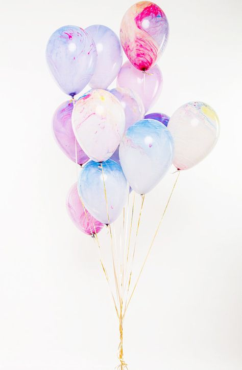 These balloons are inspired by shades of spring and have a layering watercolor effect. Each balloon is uniquely created so no two balloons look exactly alike creating a wonderful and personal touch. Each pack comes with fourteen watercolor balloons. The balloons are dyed using bright pink, blue and yellow inks to create a gorgeous swirling watercolor pattern on the surface and measure approximately 12 when fully inflated.