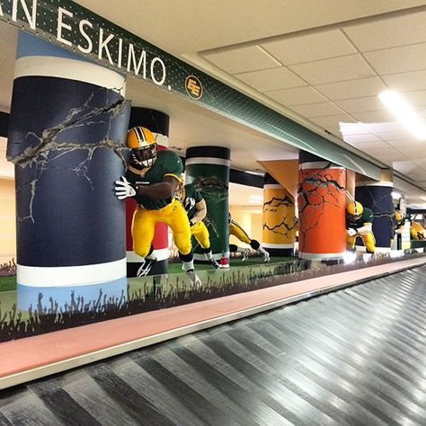column wraps and sculpture at alberta airport