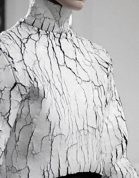 Return of the crack! Be inspired byheavily caked coatings and printed cracked effects.Balenciaga AW13/14 by Alexander Wang.  Subscribers clickherefor the full report.