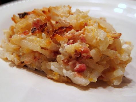 Crack Potatoes!  2 (16oz) containers sour cream 2 cups cheddar cheese, shredded 2 (3oz) bags real bacon bits 2 packages Ranch Dip mix 1 large (28 - 30oz) bag frozen hash brown potatoes - shredded kind   Combine first 4 ingredients, mix in hash browns.  Spread into a 9x13 pan.  Bake at 400 for 45-60 minutes.#Repin By:Pinterest++ for iPad#