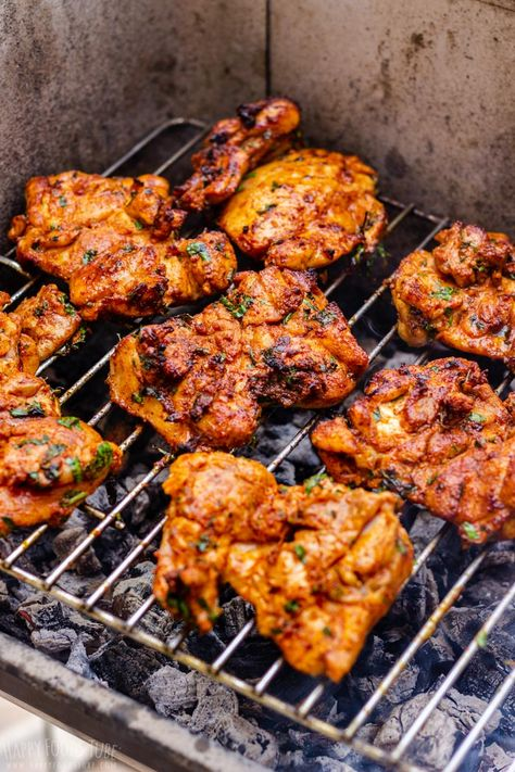 These grilled boneless chicken thighs are juicy, tender and full of flavor. Their easy prep makes them perfect for outdoor entertaining. Serve them with anything you like! #happyfoodstube #grilled #chicken #barbecue #bbq #grilling