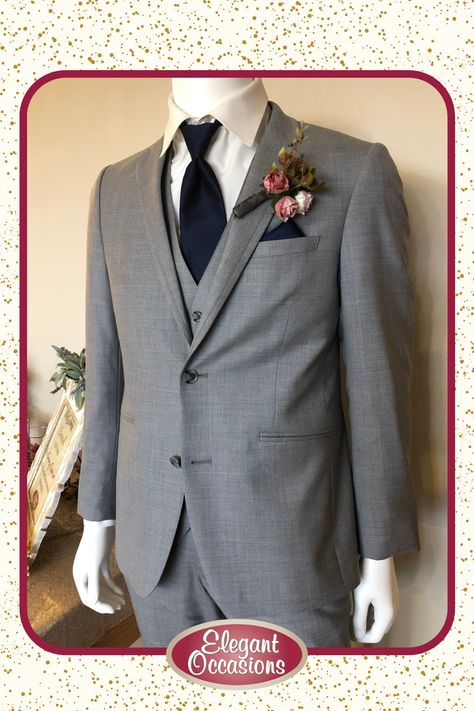 Gray Suit with Navy Accents | Schedule an appointment today to choose from all of our tux and suit options! #ImAtEO #elegantoccasions #wausauwisconsin #centralwisconsin #bridalstore #suit #suits #weddingsuit #weddingsuits #tux #tuxes #tuxedo #tuxedos #dresssuit #dresscoat #suitcoat #vest #suitvest #tie #windsortie #pocketsquare #grayandnavy #graysuit #navytie #navypocketsquare #weddingplanning #groom #groomsman #groomsmen #fatherofthebride #fatherofthegroom #wisconsinwedding #2021wedding