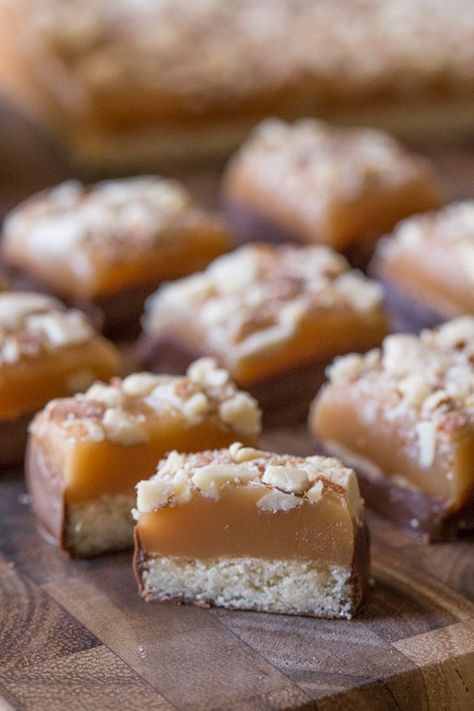 Homemade Caramel Almond Shortbread Bites - Tiny pieces of chocolate covered shortbread topped with the best ever homemade caramel and almonds! #shortbreadbites #homemadecaramel #almonds #chocolate #dessert
