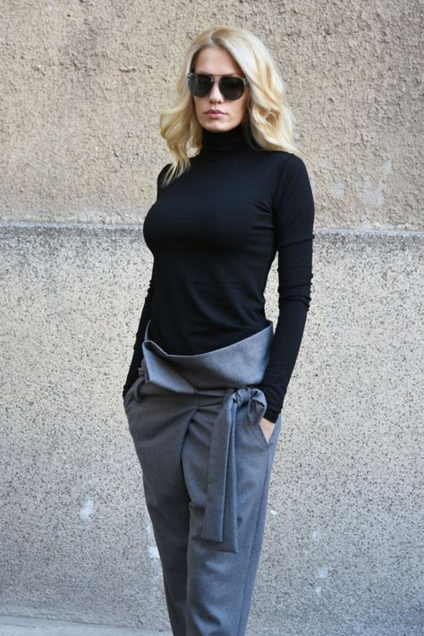 This beautiful pants are crafted from high quality fine wool fabric. These harem-style pants have a comfortable belt, which wraps you around. This pair is cut in a relaxed, dropped crotch silhouette that tapers flatteringly towards your ankle. Wear them with a loosely tailored top and