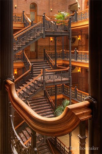 Architecture: Stairs - Bradbury Building - Industrial Revolution - Extensive use of wrought iron in the central court and open elevator cages Architecture Design, Beautiful Architecture, Beautiful Buildings, Building Architecture, Building Stairs, Victorian Architecture, Grand Staircase, Spiral Staircase, Staircase Design