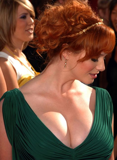 Christina Hendricks (redhead) this woman is a goddess. I do believe I found my hairstyle. but I want some more whisps hanging down the back