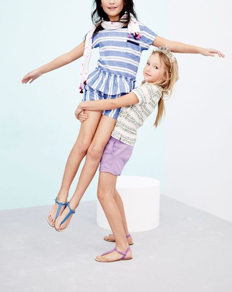 J.Crew girls' pull-on multistripe shorts, neon T-strap sandals, multistripe peplum top, and star crown headband. To preorder call 800 261 7422 or email verypersonalstylist@jcrew.com.