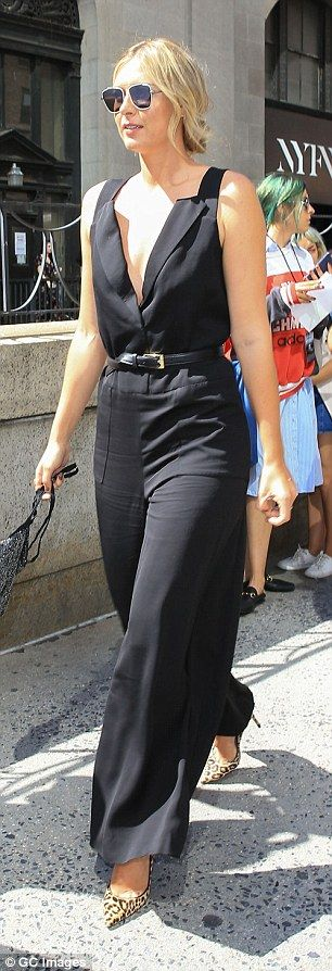 Maria Sharapova takes the plunge in a daring black jumpsuit as she rubs shoulders with Anna Wintour at the Vera Wang NYFW show