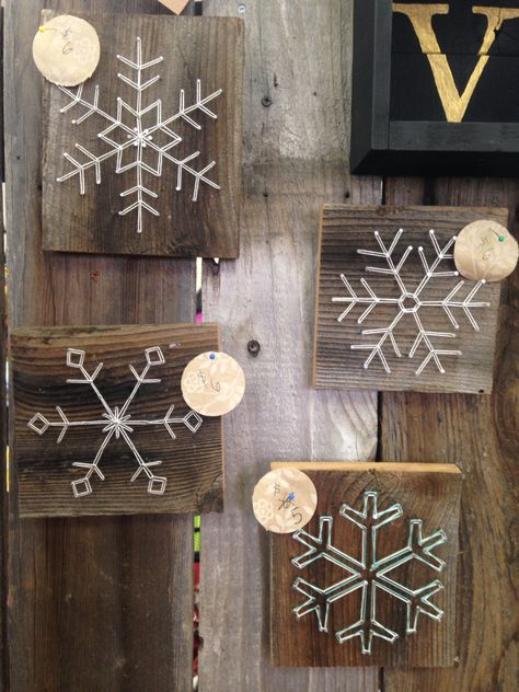 Some designed snowflakes with string and nail art! So freaking cute, and small enough to add to your Christmas decor collection