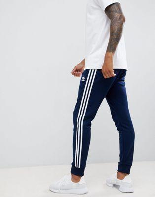 adidas Originals 3 stripe skinny sweatpants with cuffed hem