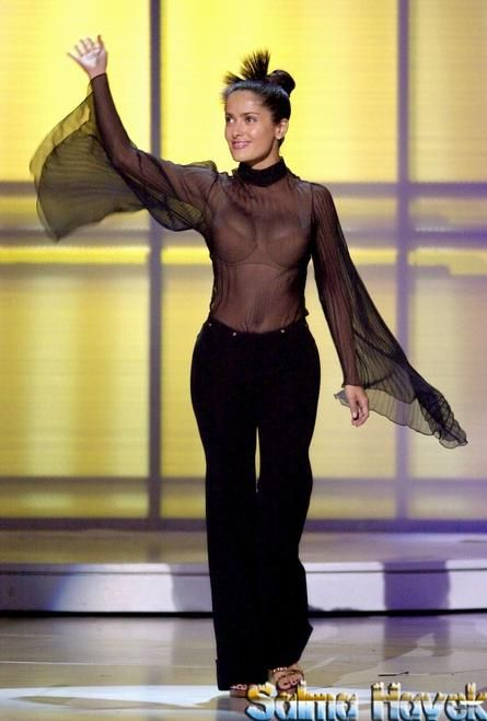 Salma Hayek presents an award at the inaugural Music Awards at the Shrine Auditorium in Los Angeles, CA in a sexy see through top, just seeing her in this top would be enough of an award to me!