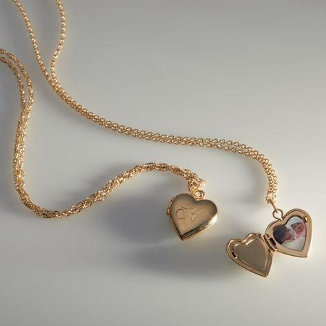 An instant heirloom, the Dollhouse Heart Locket is perfectly balanced in size and sentiment; a nostalgic classic that is just sweet enough. Dainty Jewelry, Cute Jewelry, Gold Jewelry, Jewelry Box, Jewelry Accessories, Gold Heart Locket, Heart Locket Necklace, Cute Necklace, Fashion Necklace