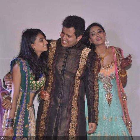 (L-R) Palak, Abhinav and Shweta enjoy a family moment during the sangeet ceremony.