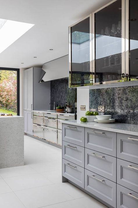A Hint Of Blue In Grey Cabinets Paired With Nickel And Wood For